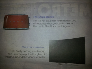 "Photo of part of a newspaper page, including the toaster image and text: ""This is not a toaster, it's..."""