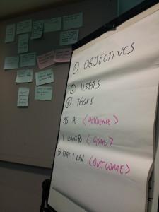 Flipchart at workshop reads: 1. Objectives, 2. Users, 3. Tasks
