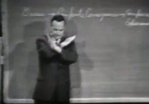 Richard Feynman presenting at Cornell University in 1964 (screengrab from You Tube clip)