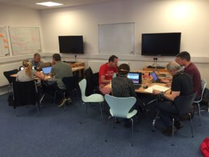 8 developers all hard at work on laptops for the code sprint