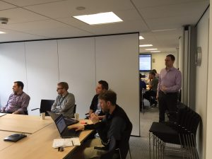 4 developers in a smaller side room with a door through to the main room