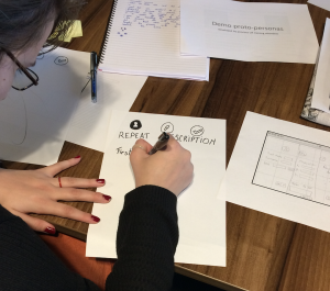 Person sketching a user interface on paper