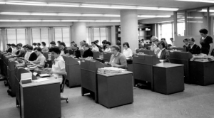 Rows of typists working in an office (probably) in the 1960s